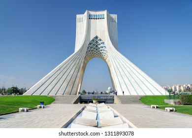 Tehran, Iran - 19 October, 2018: Scenic view of the Azadi Tower (Freedom Tower) on blue sky background. Azadi Square is a popular tourist attraction of the Middle East.