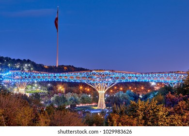 Tehran, Iran - April 28, 2017: This pedestrian two-level bridge was invented in order to connect together two large urban parks, separated by highways, view at night illumination of bridge spans.