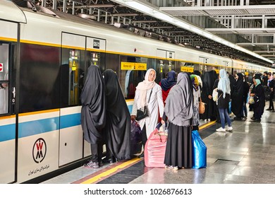 Tehran, Iran - April 29, 2017: Crowd on the platform of the metro station, women in hijabs expect the opening of the doors of the train car, intended only for women.