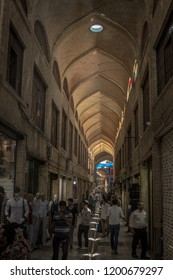 TEHRAN, IRAN - AUGUST 14, 2015: Street of the Tehran main bazar in the morning in a covered alley of the market. Symbol of Persian architecture, it's a  landmark of the capital city of Iran