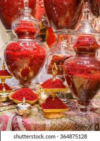 Tehran, Iran - December 6, 2015: Red Iranian saffron in glasses on market in Tehran, Iran