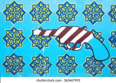 Tehran, Iran - December 7, 2015: Anti-American graffiti on the wall of Iran's Former American Embassy in Tehran