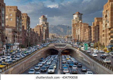 TEHRAN, IRAN - FEBRUARY 19, 2016: Heavy Traffic Congestion in and around Tohid Tunnel with Milad Tower and Alborz Mountains in Background. Tohid is the third longest urban tunnel in Middle East.