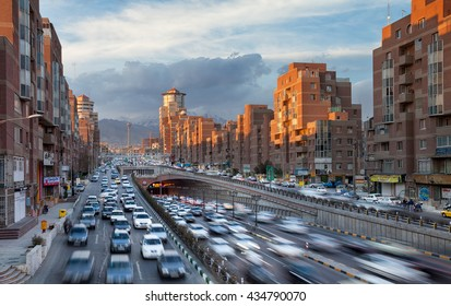 TEHRAN, IRAN - FEBRUARY 19, 2016: Tehran Cityscape with Cars Passing Through Tohid Tunnel in Front of Sunlit Navvab Buildings. Tohid Tunnel is the third longest urban tunnel in Middle East.