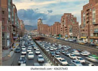 TEHRAN, IRAN - FEBRUARY 19, 2016: Cars Passing Through Tohid Tunnel with Milad Tower and Alborz Mountains in Background. Tohid Tunnel is the third longest urban tunnel in Middle East.