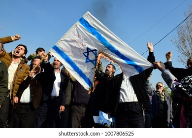 TEHRAN, IRAN - JANUARY 05: Iranian worshippers shout slogan after Friday prayer during a rally against anti-government protests on January 05, 2018 in Tehran, Iran. Protesters fire the flag of Israel