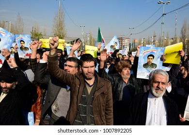 TEHRAN, IRAN - JANUARY 05: Pro-government demonstrators march in support of the regime after the weekly Friday Prayers on January 05, 2018 in Tehran, Iran.