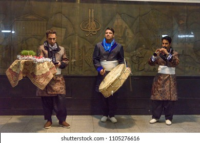 Tehran, Iran - March 19, 2018: Local street musicians play music in the metro station before Nowruz holiday