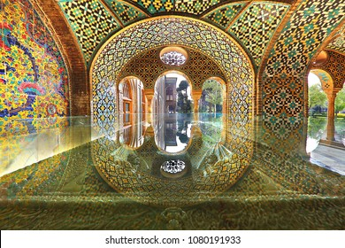 TEHRAN, IRAN - MARCH 28, 2018: Reflection of the arch over a glass case, in the gazebo of the Golestan Palace, in Tehran, Iran. Golestan Palace is the former royal complex.