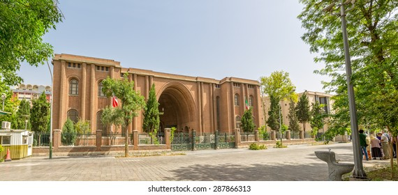 TEHRAN, IRAN - MAY 1, 2015: The National Archaeological Museum of Iran building designed by the French architect Andre Godard in the early 20th century and tourists in front of it.