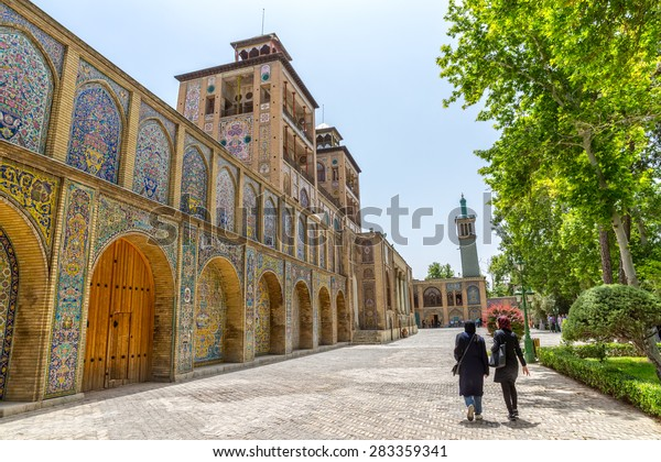 TEHRAN, IRAN - MAY 1, 2015: Visitors walking infront of the Edifice of the Sun the royal palace Golestan oldest groups of buildings in persian capital, was rebuilt to its current form in 1865.