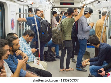 TEHRAN, IRAN - MAY 22, 2017: People at metro train in Tehran. The metro system consists of 7 operational metro lines