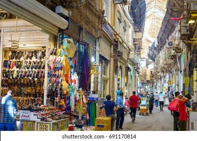 TEHRAN, IRAN - MAY 22, 2107: People at Tehran Grand Bazaar. The Grand Bazaar is an old historical market in Tehran.
