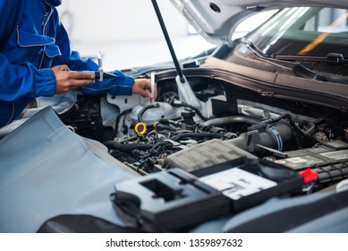 Tehran / Iran - November 2018: technician working on checking and service car in workshop garage; technician repair and maintenance engine of automobile in car service - Image