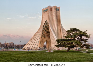 TEHRAN, IRAN - NOVEMBER 25, 2016: View of the Azadi Tower in the light of the setting sun. The tower is one of the symbols of the city and Azadi Square most visited place by tourist.