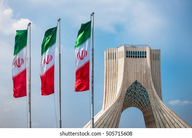 Tehran, Iran - Oct 25, 2016 : Azadi Tower with flasgs of Iran, Tehran, Iran
