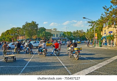 TEHRAN, IRAN - OCTOBER 11, 2017: The bikes wait for the traffic light on the intersection of Amir Kabir and Mostafa Khomeyni streets, on October 11 in Tehran.