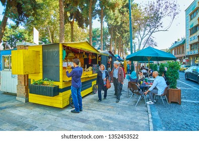 TEHRAN, IRAN - OCTOBER 25, 2017: Food court in 30 Tir street is popular among tourists and locals, enjoying their time in park or shady terraces with snacks and soft drinks, on October 25 in Tehran.