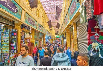 TEHRAN, IRAN - OCTOBER 25, 2017: The crowded alleyway of Tajrish Bazaar with beautiful Persian styled tiled signs above the stalls, on October 25 in Tehran.