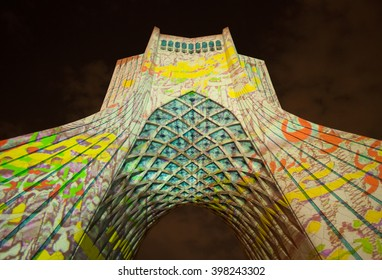 TEHRAN, IRAN - OCTOBER 4, 2015: Light Concert entitled Gate of Words projected on Azadi Monument. The Light Show was designed by Philipp Geist exclusively for this landmark of Tehran.