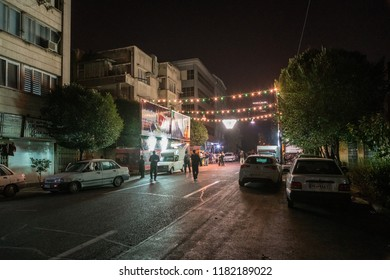 TEHRAN, IRAN - SEPTEMBER 21, 2017: Ashura tea stall in the backstreets of Tehran, Iran. During Ashura, makeshift stalls are set up in cities across  the country to provide free cups of tea to mourners