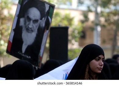 TEHRAN, IRAN - SEPTEMBER 23, 2006: People in the Imam Khomeini street holding the picture of Imam Khomeini for Day of The Revolution, in central Tehran, Iran.