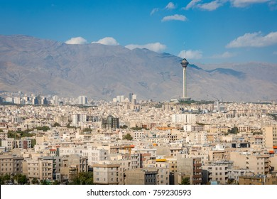 Tehran Iran skyline city view with flag, road, cars, houses, mosque, tower and parks. Tehran is the capital city of Iran and the biggest city in the middle east