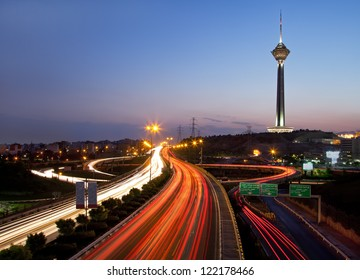 TEHRAN - JULY 16: Night shot from streets of Tehran and Illuminated Milad Tower on July 16, 2011 in Tehran, Iran. Milad Tower is the second most important landmark of Tehran, after Azadi Monument.