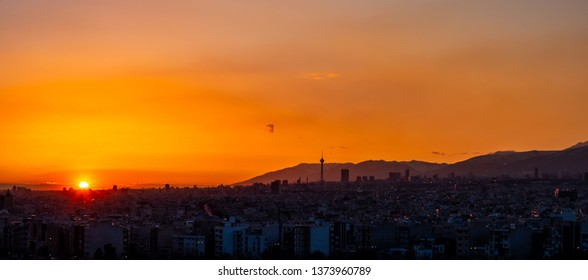 Tehran skyline at the sunset with Milad tower in the frame, colorful photo of Tehran-Iran cityscape