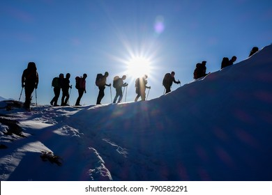 Tehran,/Iran- 01 05 2018:  A group of climbers is going to the summit in a snow mountain and blue sky.
