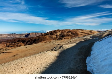 Teide National Park, Tenerife, Canary Islands - colourful soil of the Montana Blanca volcanic ascent trail. This scenic hiking path leads up to the 3718 m Teide Peak, the highest peak in Spain