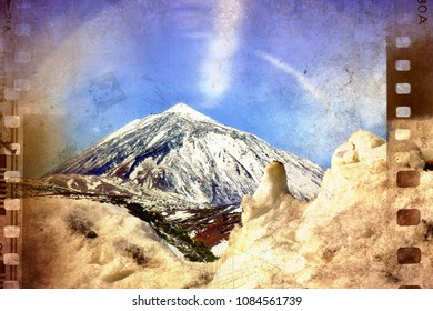 The Teide on Tenerife with snow. Piles of snow piled up in front of it, all in close-up. The sky above blue with blurring veil clouds blurred. Recorded at 2300 m altitude. the edges like a film stripe