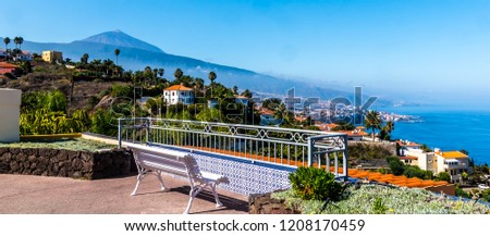 Teide, Tenerife, Spain - A seat to relax, overlooking the Teide volcano (Teyde) and Puerto de la Cruz, the eighth largest city in Tenerife, is the tourist center of the island north coast, in October.