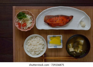 Teishoku is a Japanese set meal that typically includes a main course (such as grilled fish or breaded pork cutlets), a bowl of rice, some side dishes, and miso soup.