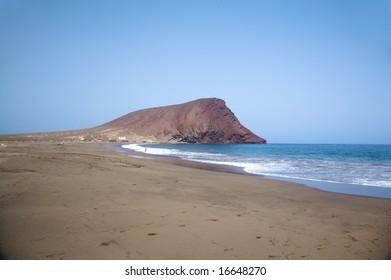 tejita beach with the red mountain at tenerife