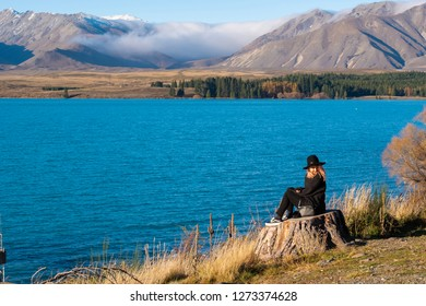 Tekapo lake -May 11,2018:Tourist sitdown with beautiful landscapes view of Tekapo Lake at newzealand in the evening.