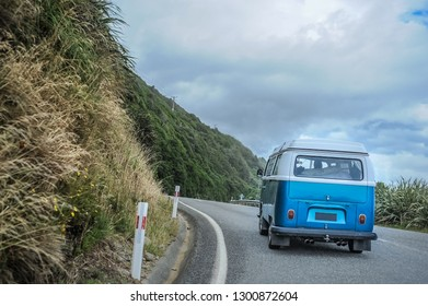Tekapo,  New Zealand - Circa Jan 2009: A vintage Volkswagen van drives on mountain roads through south island scenery.
