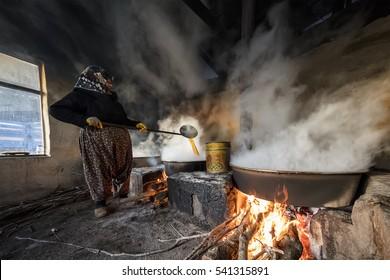 Tekirdag - Turkey December 04-2016 ;The woman who makes the molasses. Grape molasses.