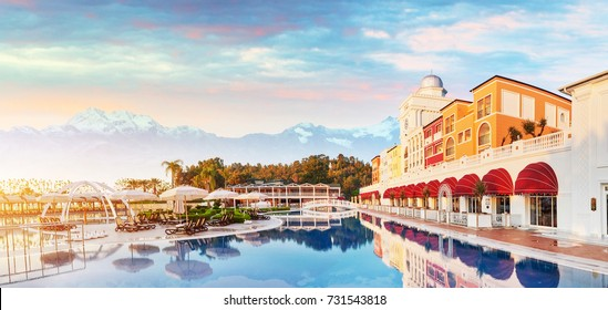 TEKIROVA TURKEY - APRIL 25 2017: Swimming pool and beach of luxury hotel. Snowy with mist at sunny day. Amara Dolce Vita Luxury Hotel. Resort. Tekirova-Kemer. Turkey