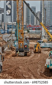Tel Aviv - 10.06.2017: Construction site machinery and workers in Tel Aviv.