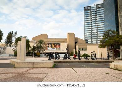 Tel Aviv, Tel Aviv-Yafo, Israel - December 28, 2018: People taking pictures of metal sculptures of bird and human silhouettes  in front of Museum of art in Tel Aviv, Israel