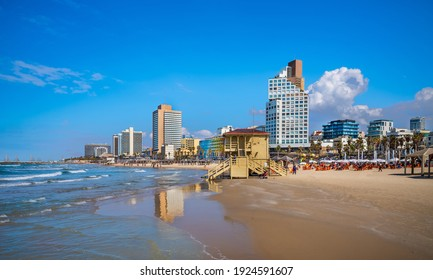 Tel Aviv beach with a view of Mediterranean sea and sea front hotels, Israel.