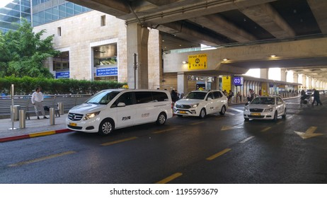 TEL AVIV, BEN GURION AIRPORT. October 5, 2018. White taxi cabs in front of the ground floor entrance of the Ben Gurion international airport. Only few taxi parks are allowed to operate here.