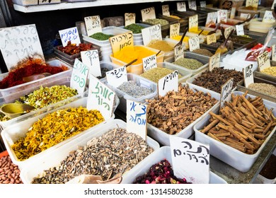 Tel Aviv, Carmel Market, Israel - December 28, 2018: Spices in great variety of taste, scent and  colour with price labels on stand at Carmel  market in Tel Aviv-Yaffo, Israel