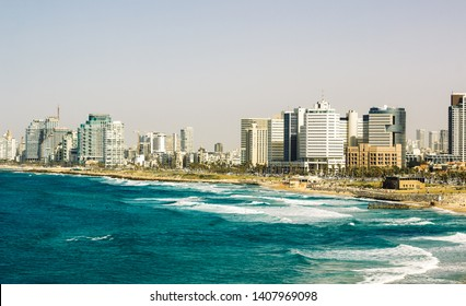 Tel Aviv cityscape capital of Israel panoramic photography format with Mediterranean sea coast line beach and skyscrapers building along waterfront, summer vacation destination place
