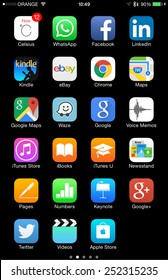 TEL AVIV - FEB 13, 2015: High resolution Apple and other common iOS  icons on iPhone, isolated on black and ready to cut and use - illustrative editorial