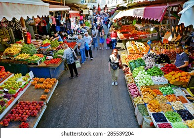 TEL AVIV, ISR - MAR 24 2015:Shoppers at Carmel Market Shuk HaCarmel in Tel Aviv, Israel.It's a very popular marketplace in Tel Aviv sells mostly food and home accessories goods.