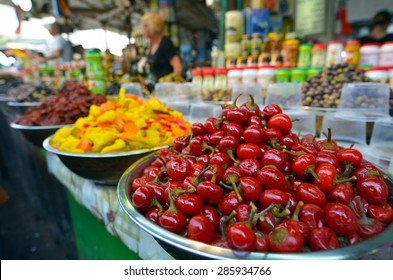 TEL AVIV, ISR - MAR 27 2015:Shoppers at Carmel Market Shuk HaCarmel in Tel Aviv, Israel.It's a very popular marketplace in Tel Aviv sells mostly food and home accessories goods.