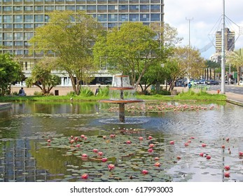 TEL AVIV, ISRAEL - APRIL 02, 2017: Recreation area with vacation people, fountain and blossom plants in Rabin Square in Tel Aviv.