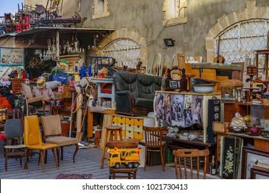 TEL AVIV, ISRAEL - APRIL 05 , 2017: A vendor selling products of any imaginable variety in Old Jaffa Flea Market ( Shuk Hapishpishim )